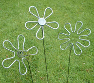 Three hand forged steel flowers garden art by ironvein.com